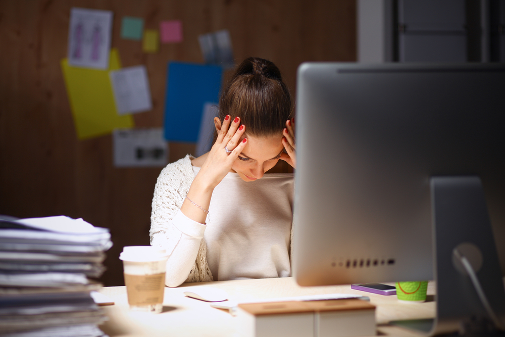 Girl stressed at desk
