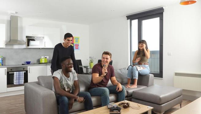 People sat in living room