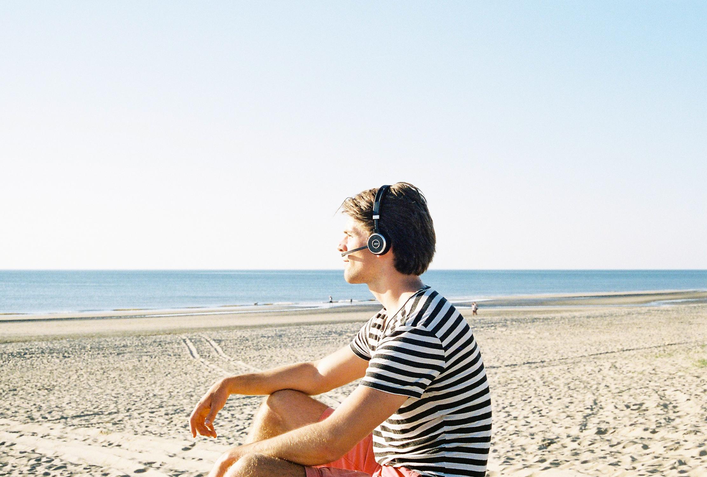 Guy with headphones on beach