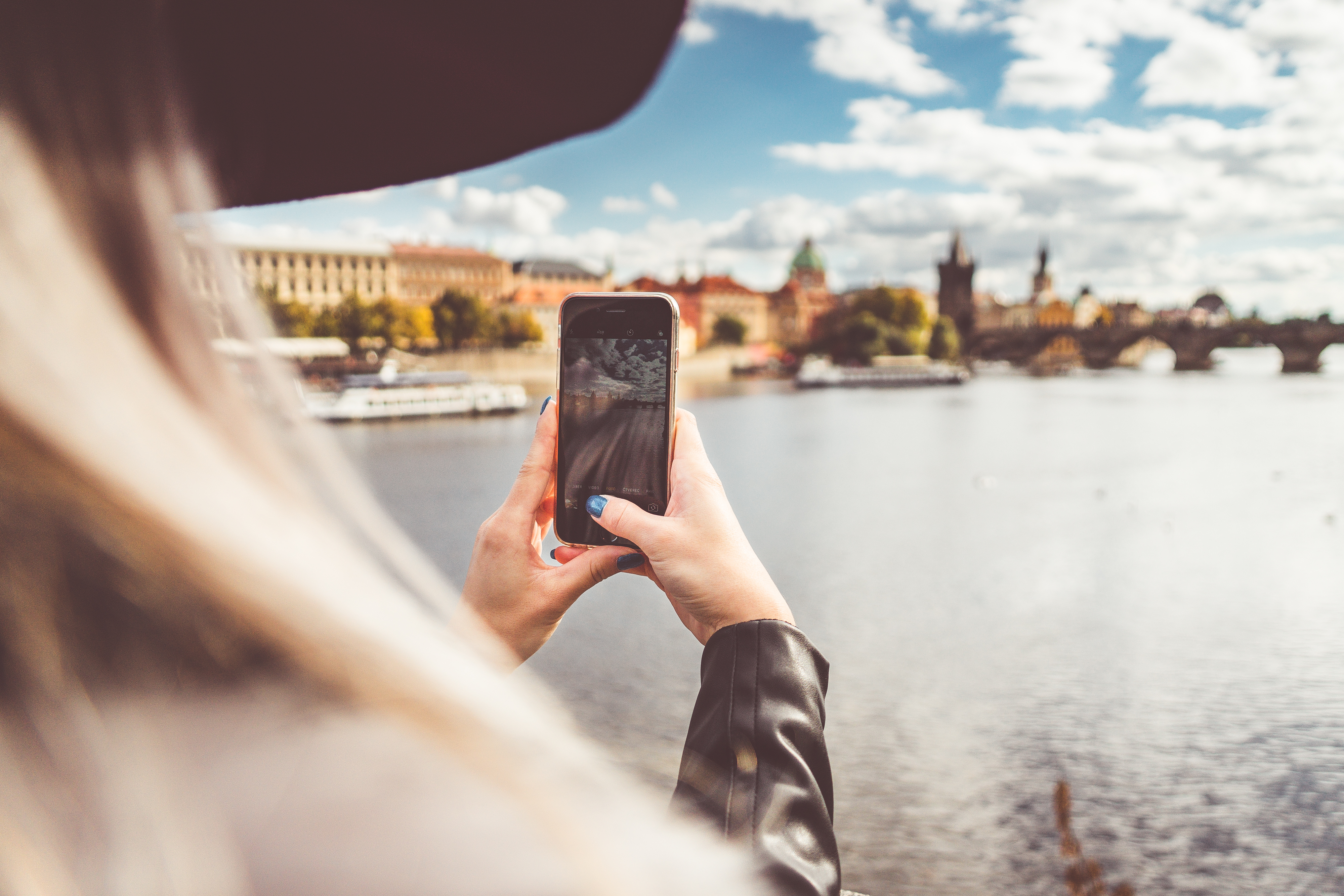 Girl taking picture of city