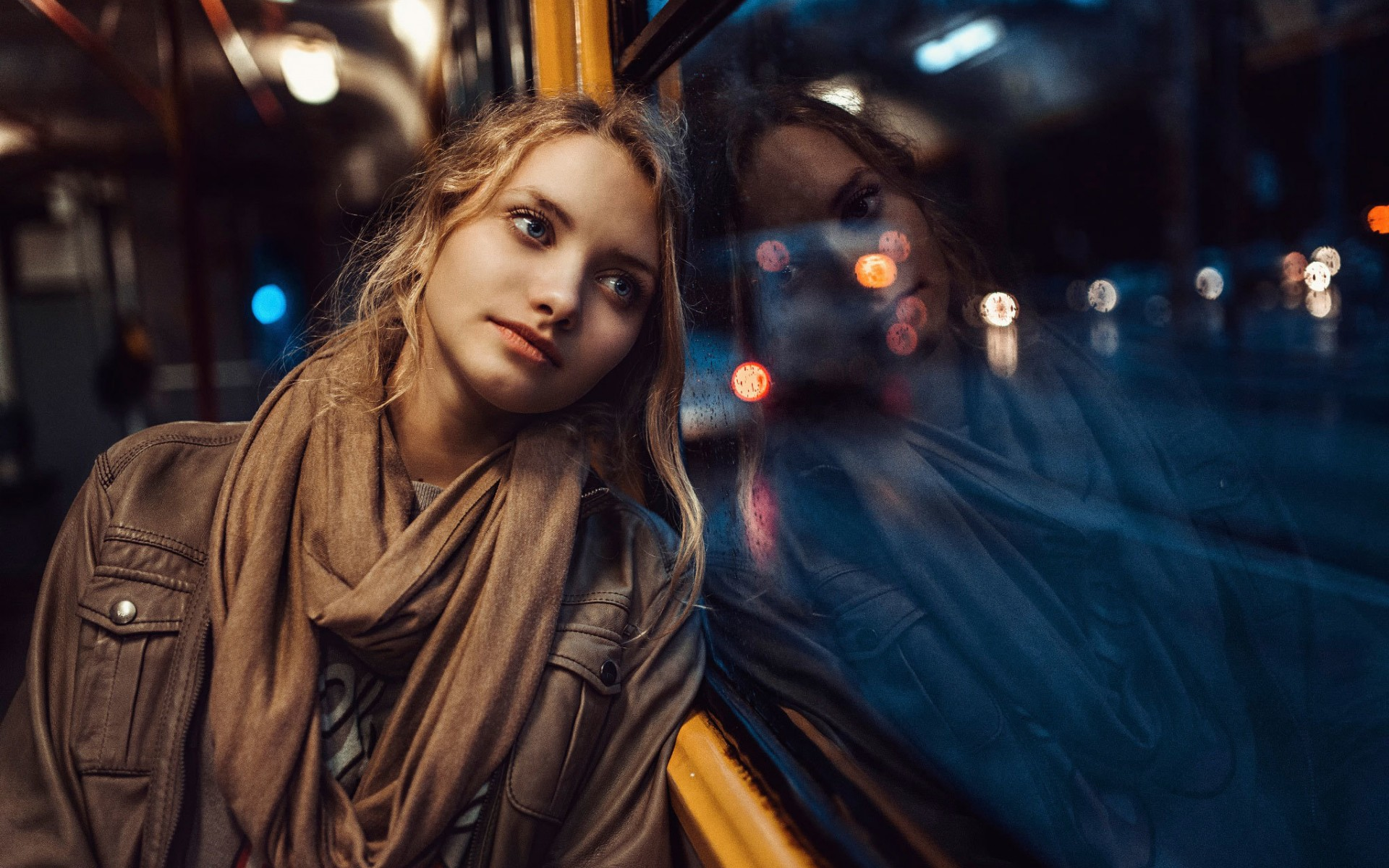 Girl leaning against bus window